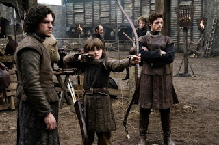 From left to right: Jon Snow, Bran Stark, Rob Stark, and if you look closely little Rickon Stark in the background.